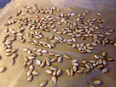 butternut seeds on baking sheet
